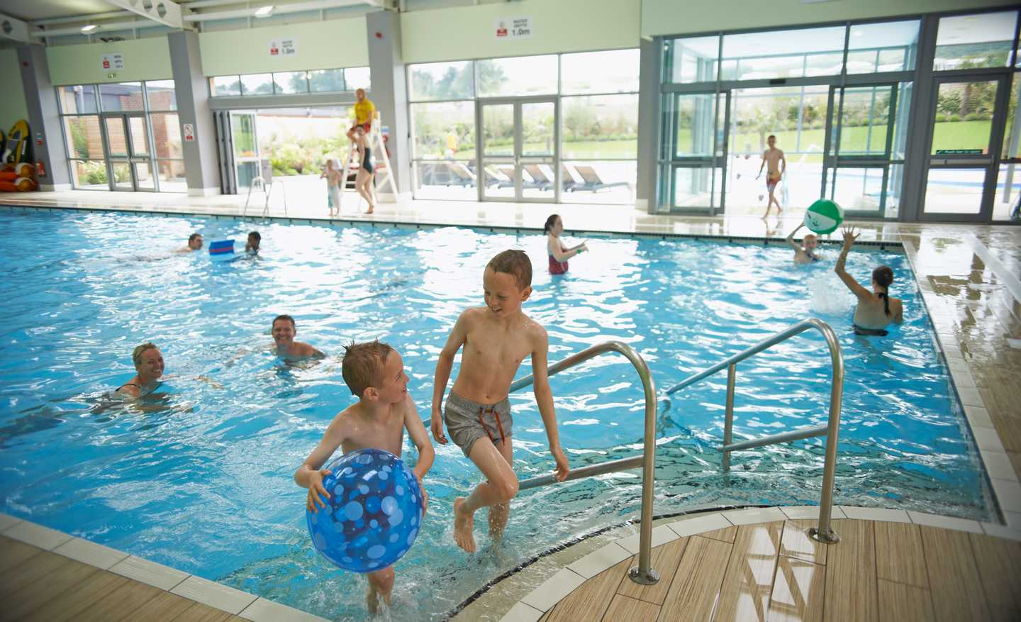 Families enjoying the heated indoor pool