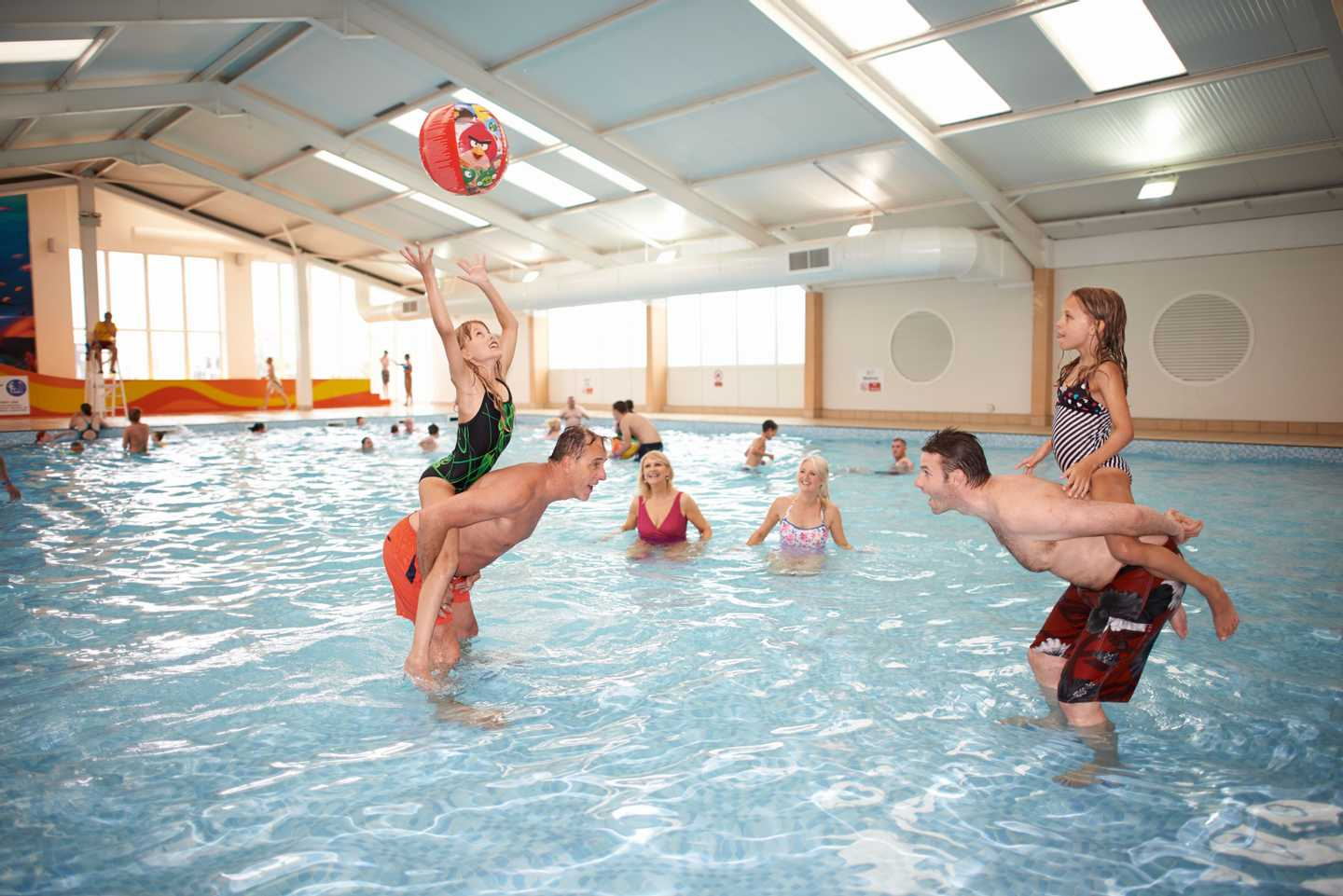 Families splashing about in the heated indoor pool