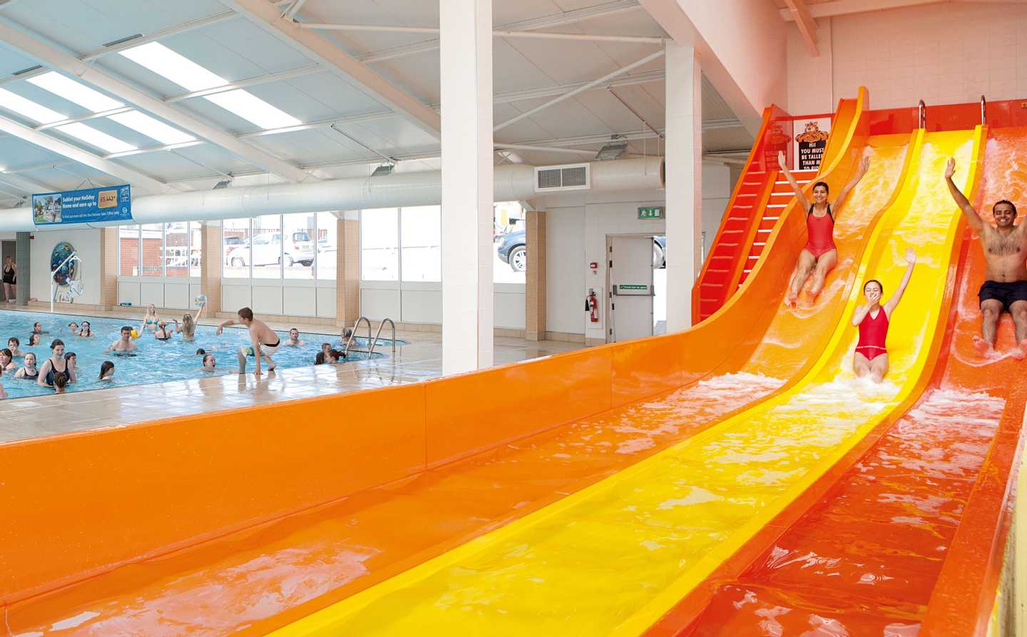 Guests whizzing down the indoor water slide