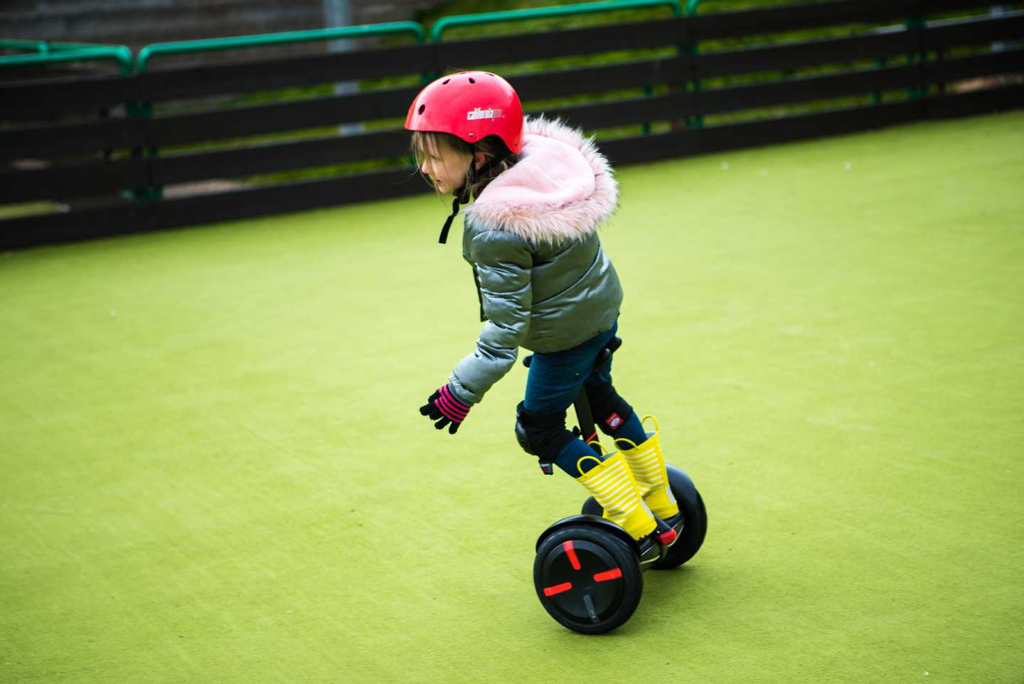 Girl riding on a junior segways