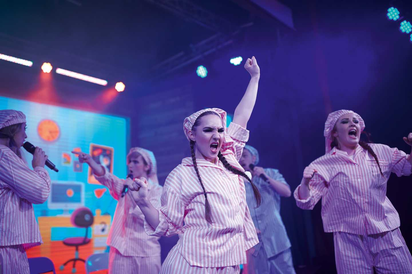 Cast performing live onstage