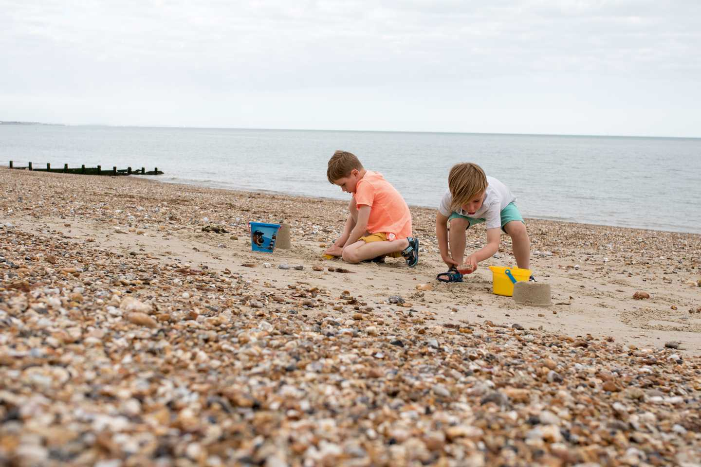 2 Boys playing by the seashore