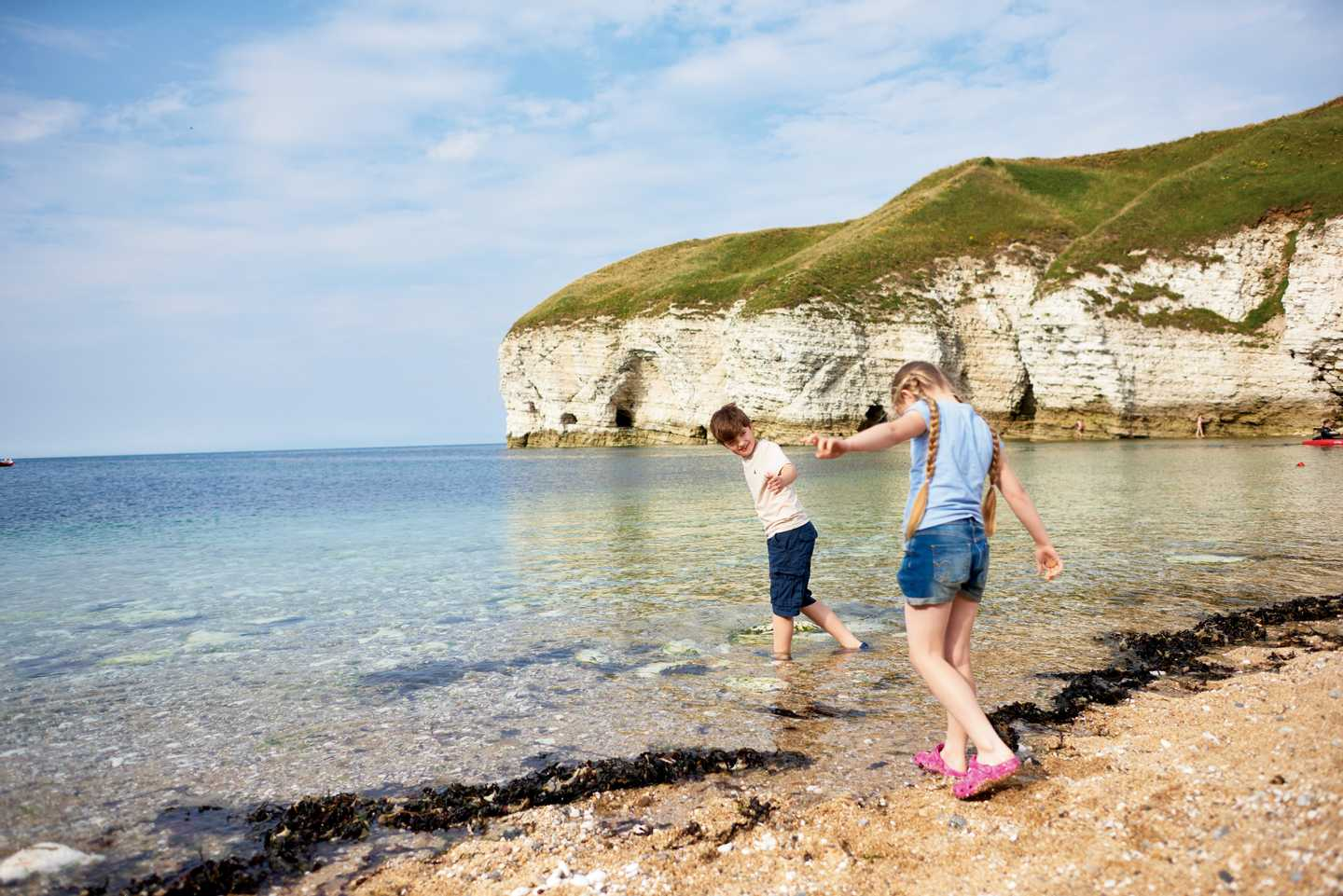 Boy and girl by the seashore at Thornwick Bay
