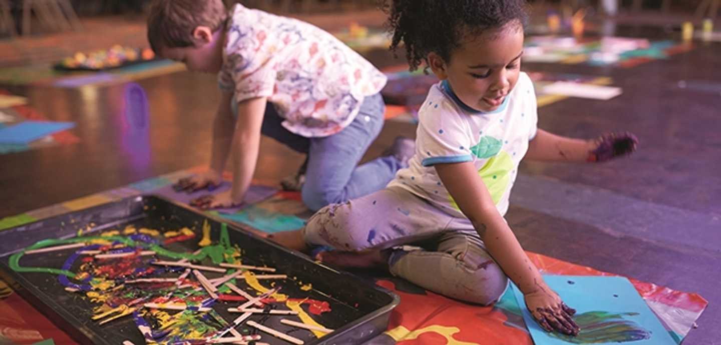 Children exploring with paints