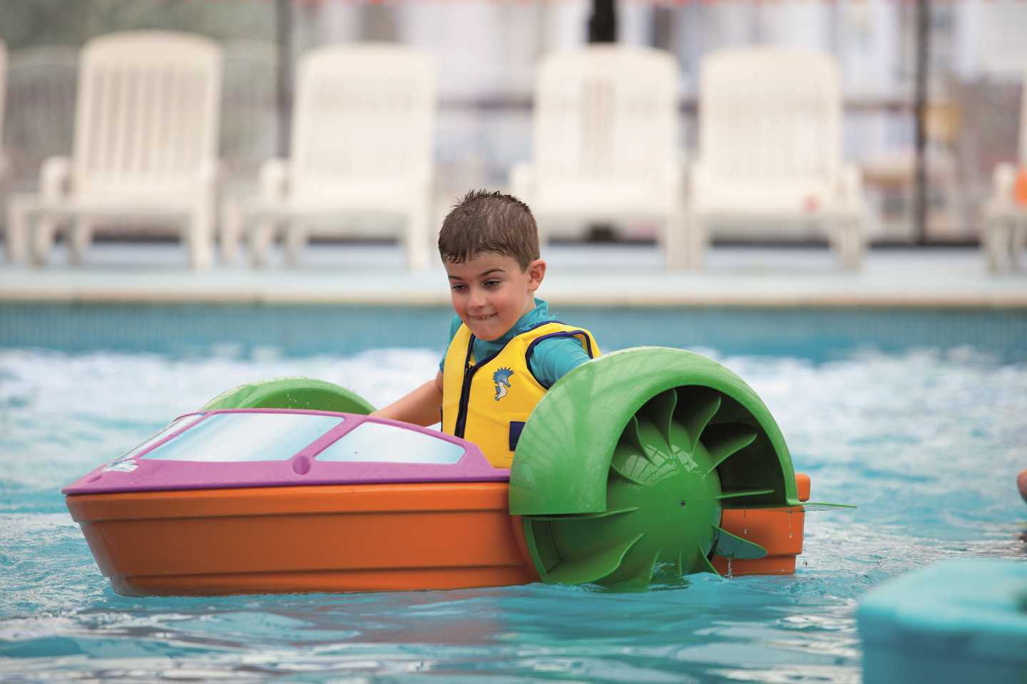 Boy in pool on Turbo Paddler