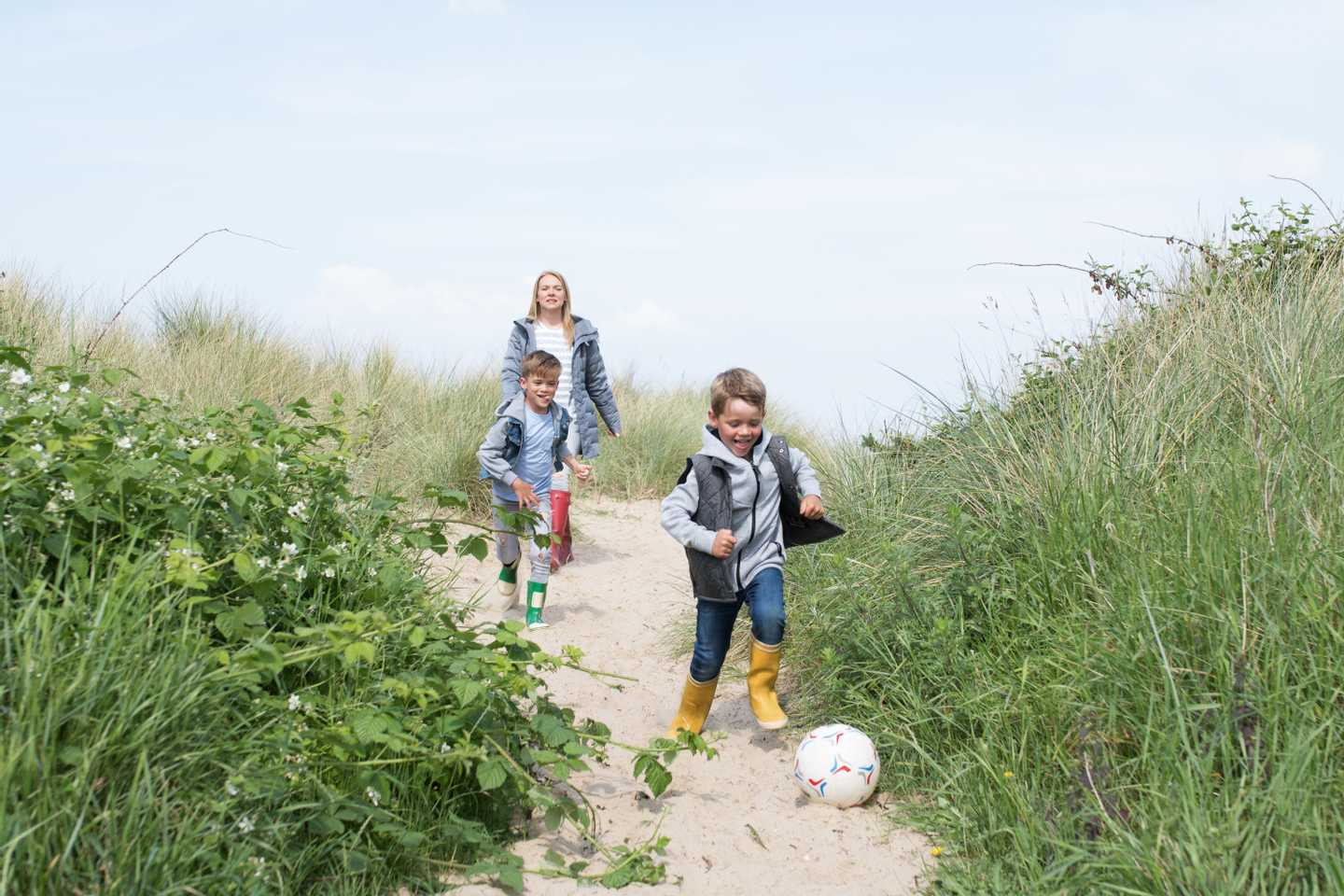 Guests walking through the entrance to the beach at Caister-on-Sea