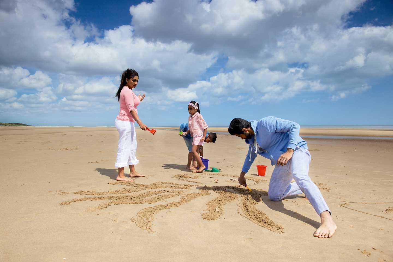 Family enjoying beach holiday in UK