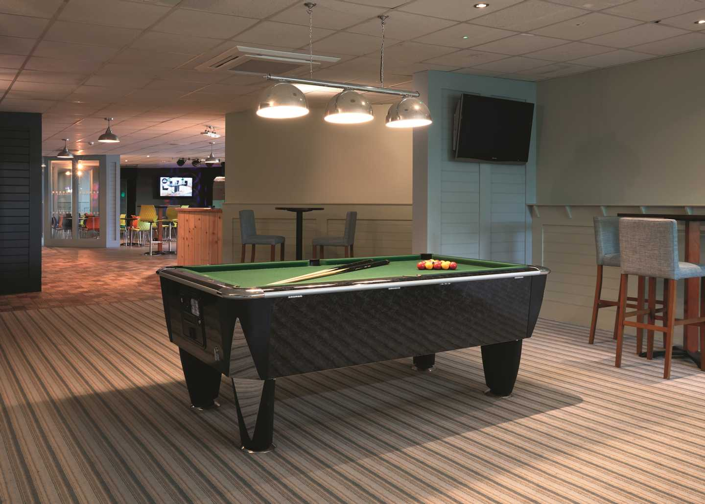 A pool table at the Saxon Family Venue