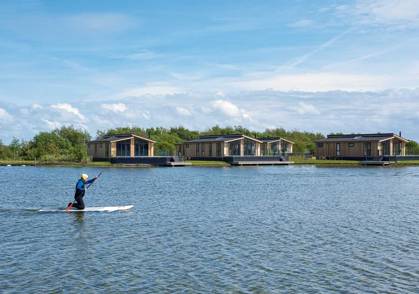 A person paddleboarding on the lake