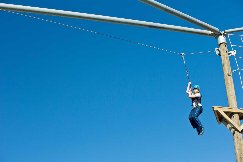 A boy riding a zip line