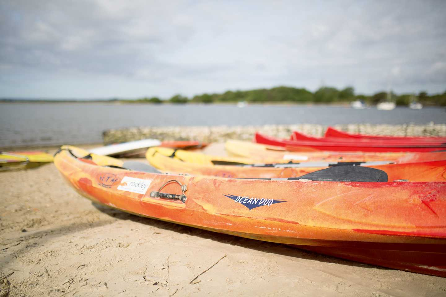 Kayaks on the beach at Rockley Park