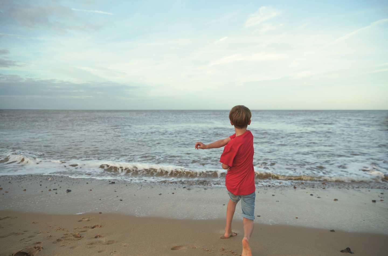 Skimming stones in the sea at Devon Cliffs