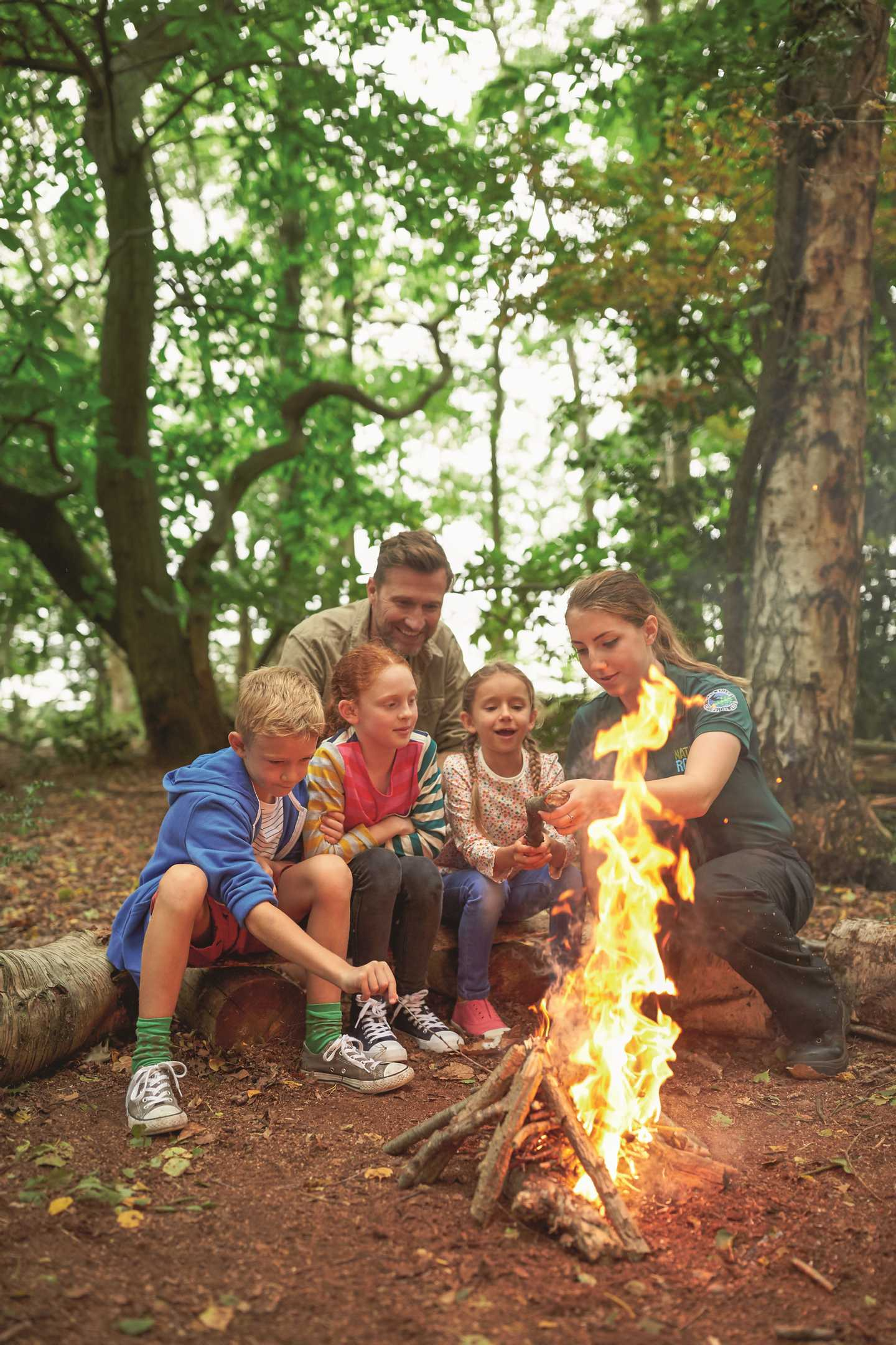 Kids and ranger fire lighting