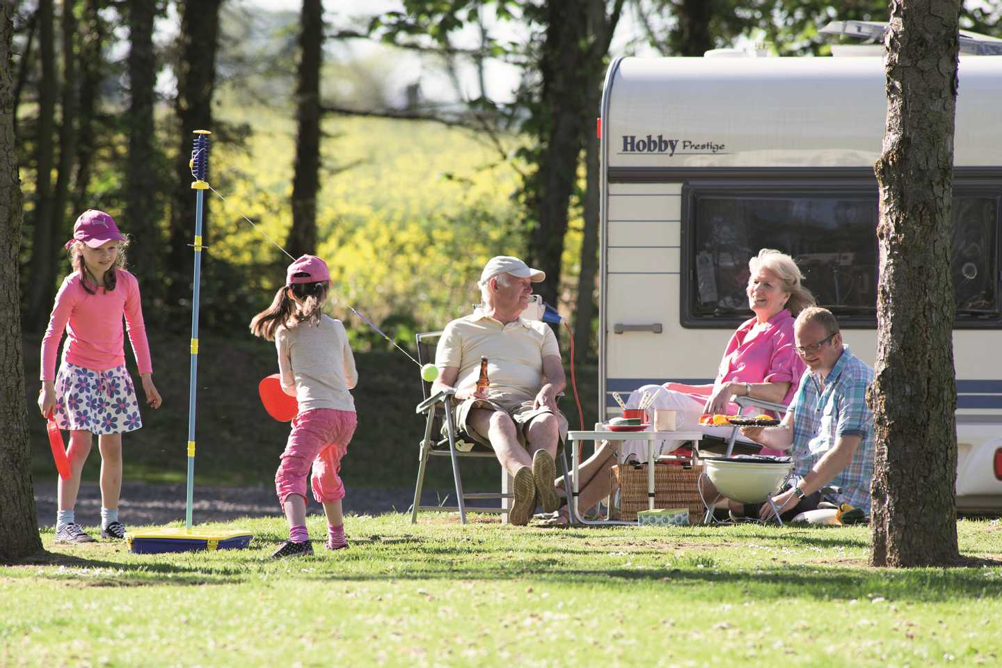 Guests playing by their motorhome