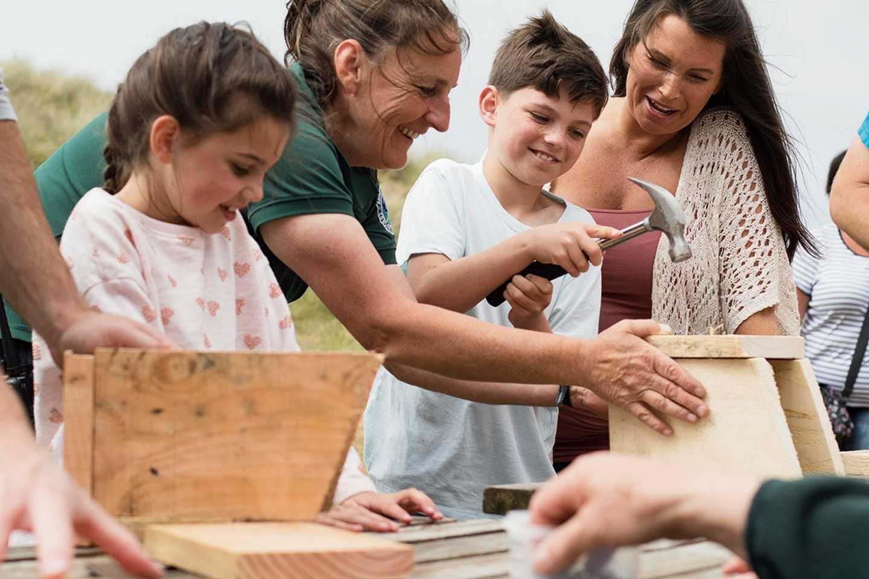 Family making a nest box