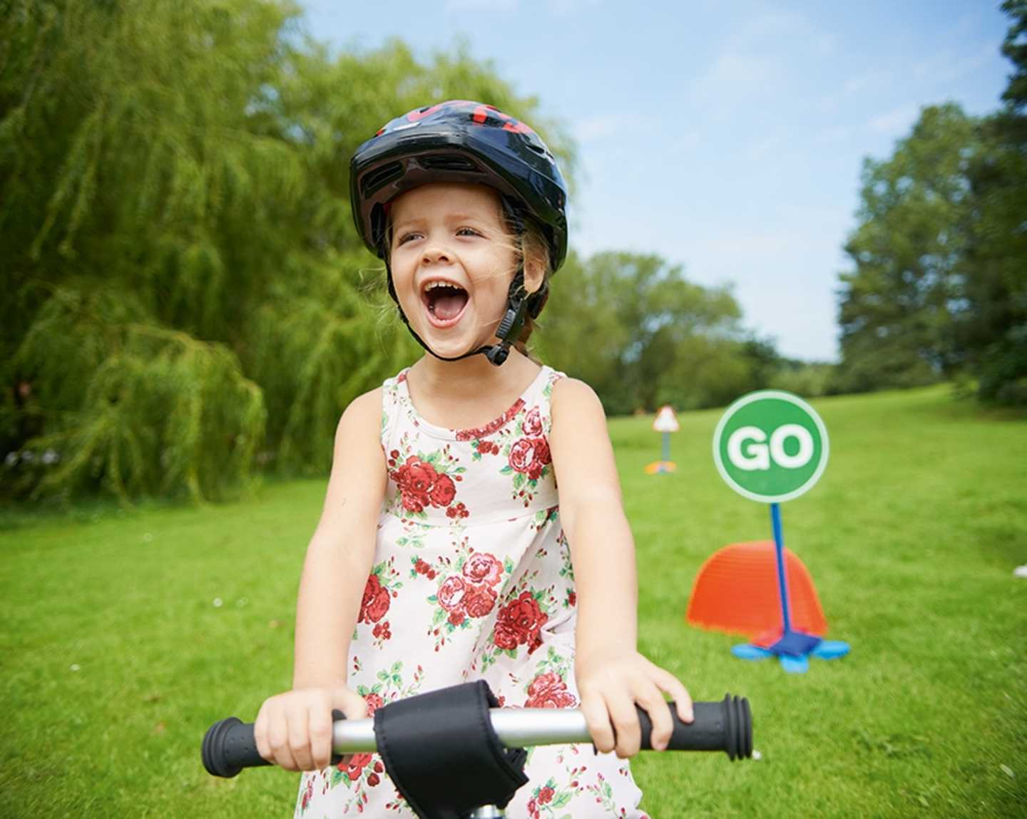 Girl enjoying learning to cycle in a Learn2Bike session
