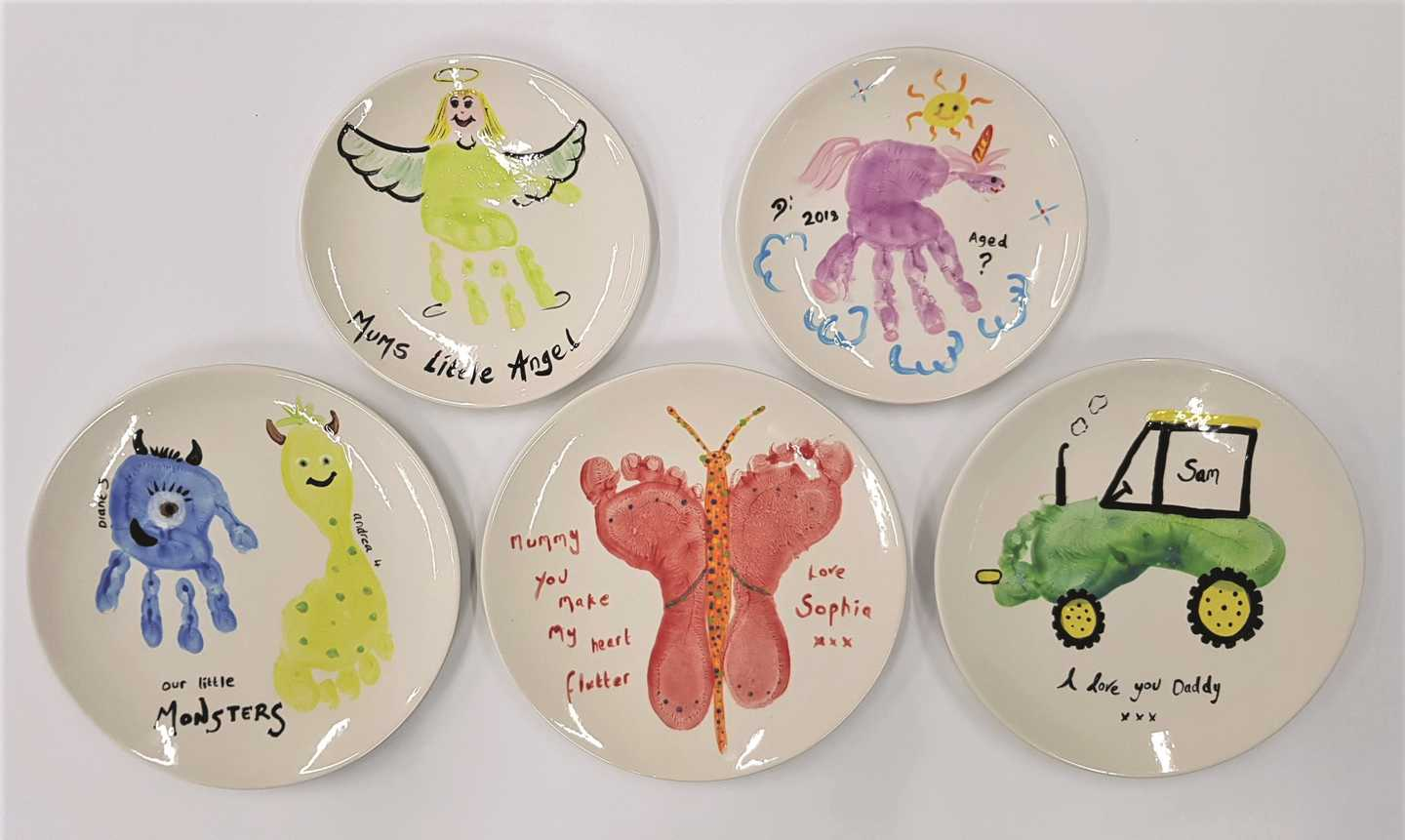 Decorative ceramic plates with painted hand and foot prints
