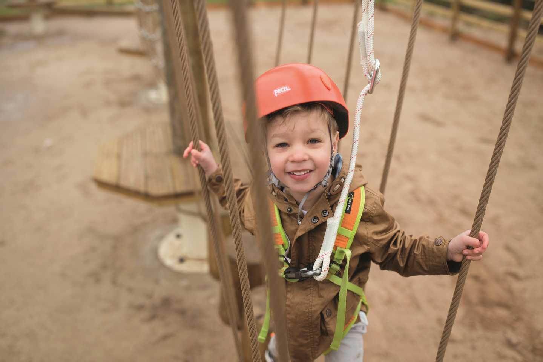 A boy on the Mini Aerial Adventure