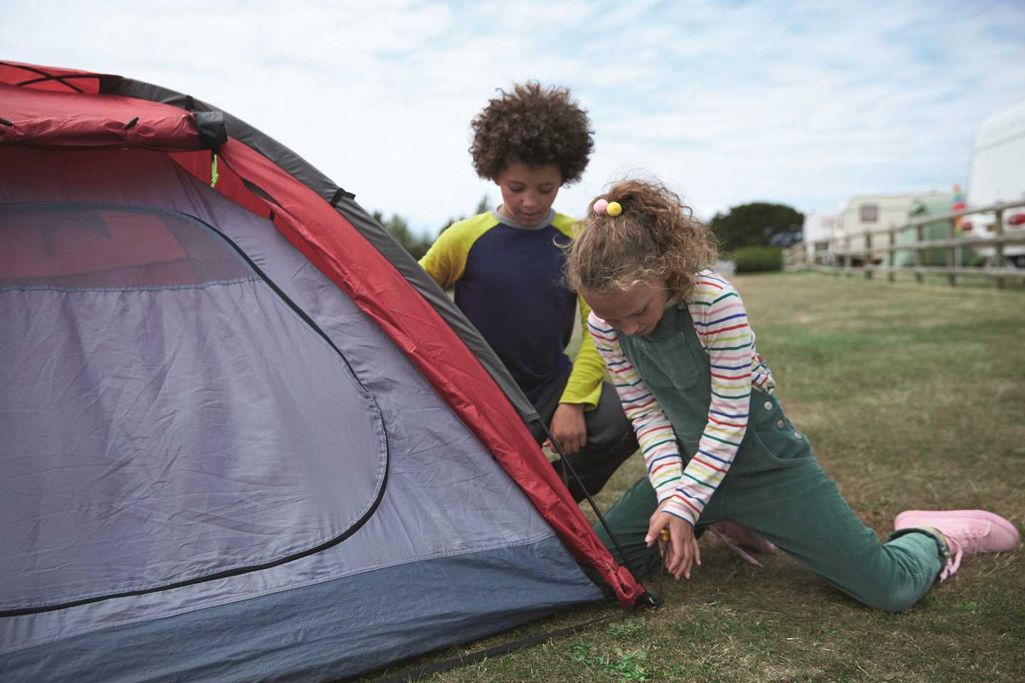 Haven holiday guests putting up their tent on the touring field