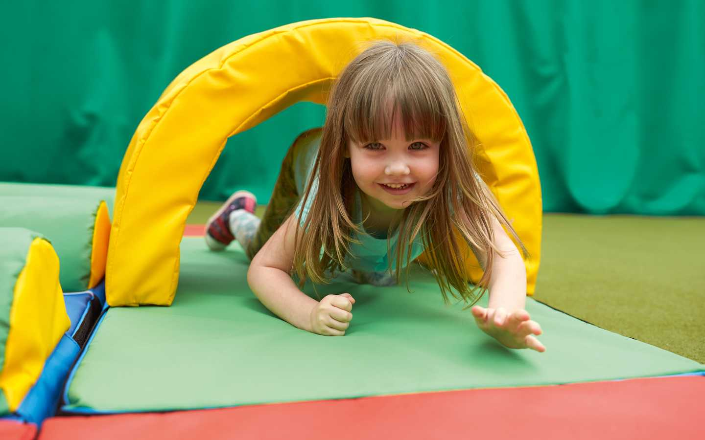 Toddler playing in the soft play area