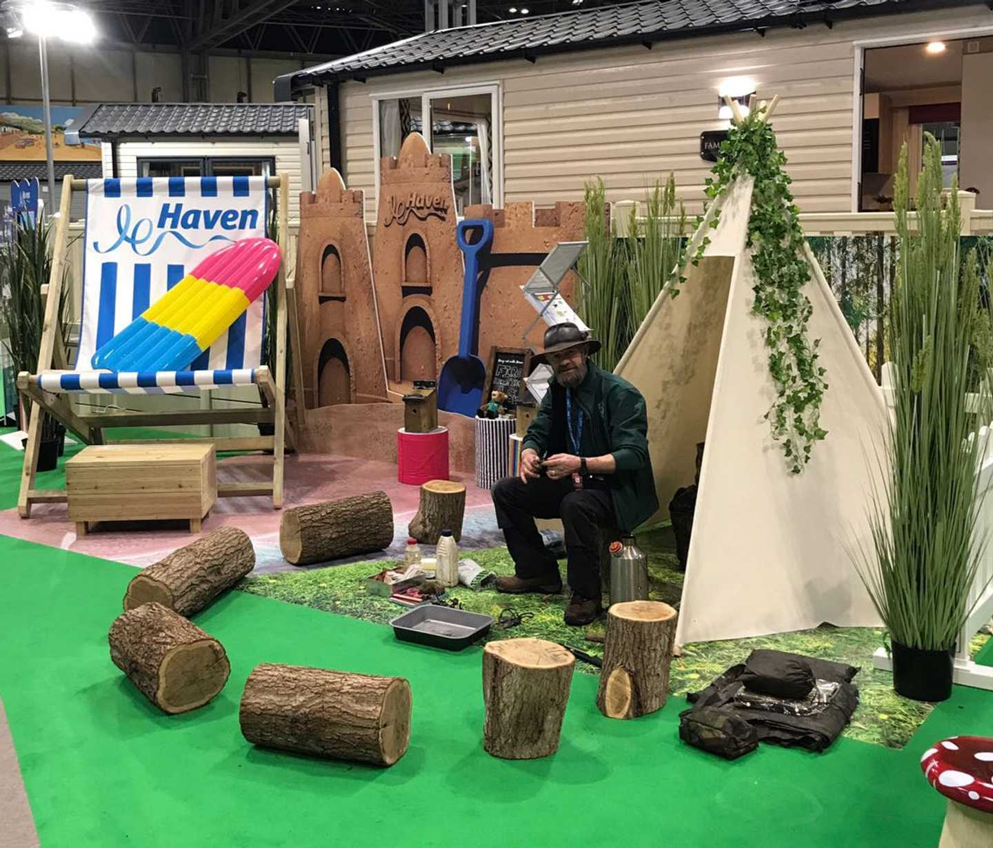 A park Ranger sitting outside a caravan at the NEC