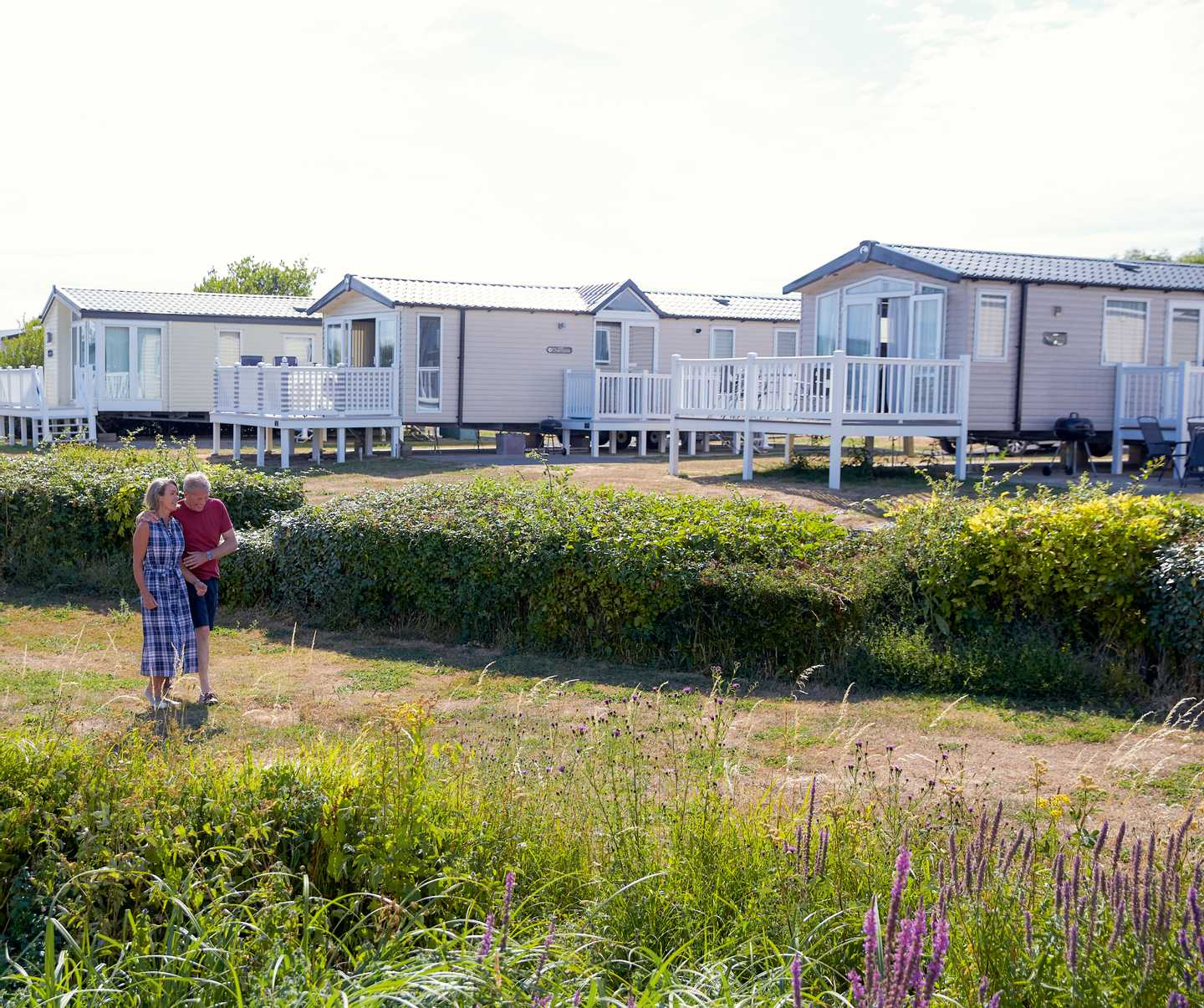 A couple walking through Littlesea Holiday Park