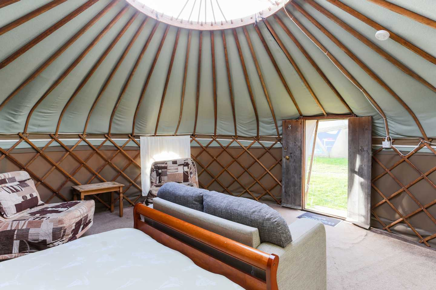 The armchairs and sofa in a Yurt