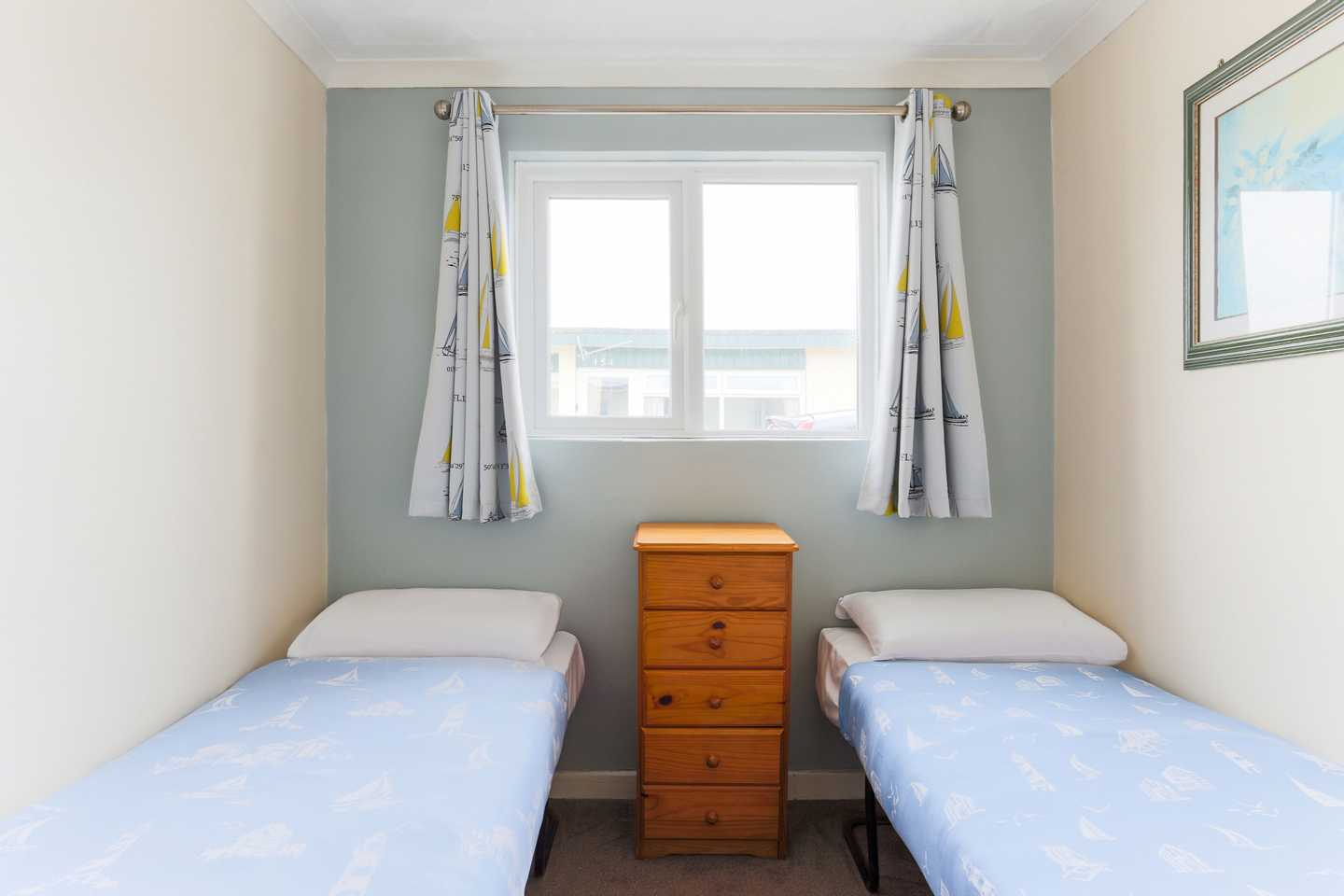 Twin beds in a second bedroom in a Standard chalet