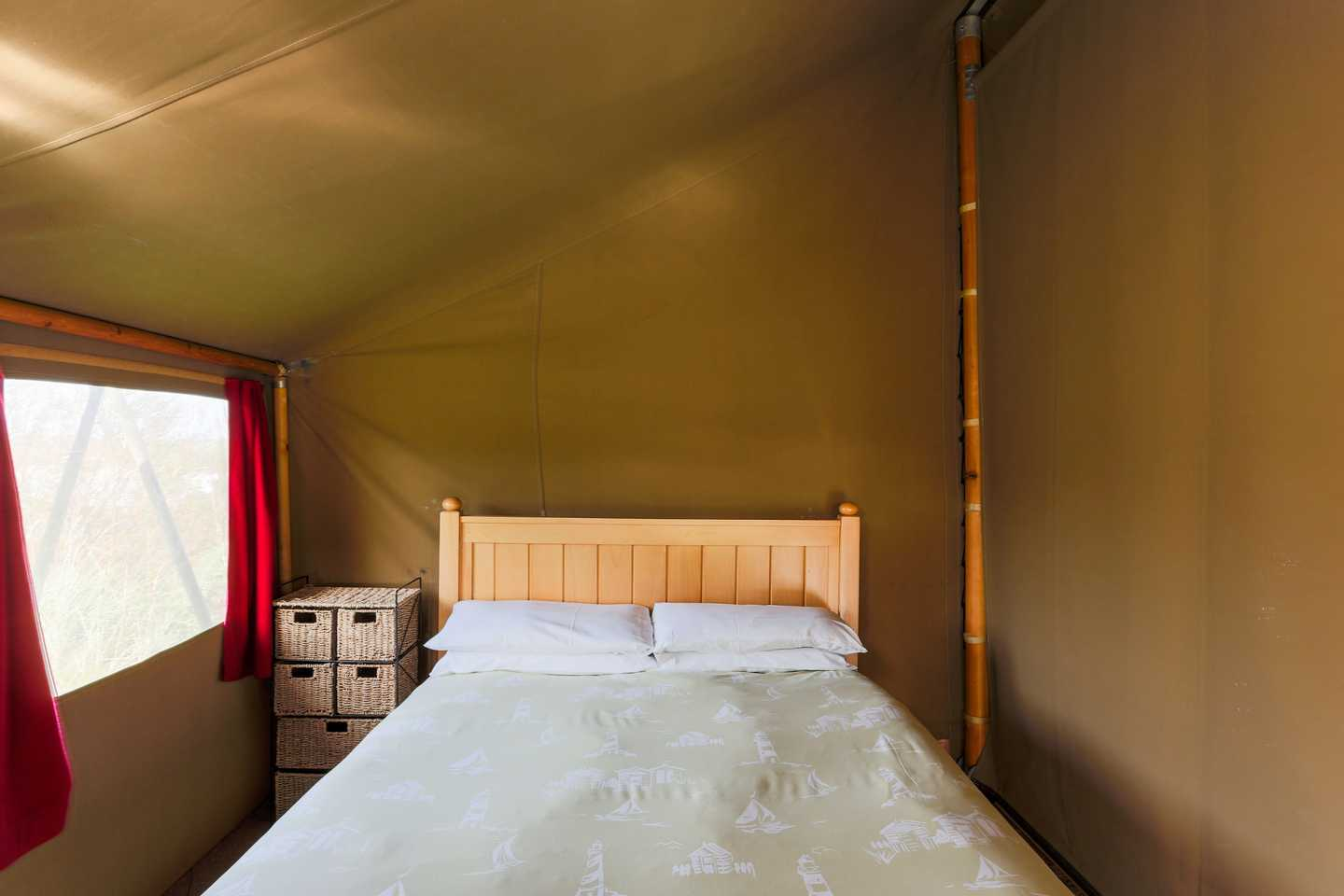 Master bedroom with double bed in a Safari Tent