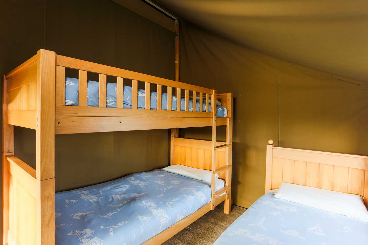 Single bed and bunk beds in a Safari Tent