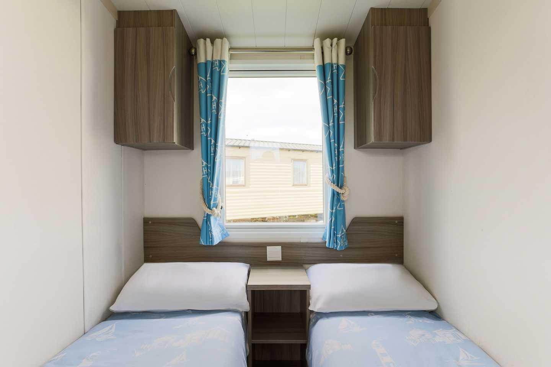 A twin bedroom in a Standard caravan