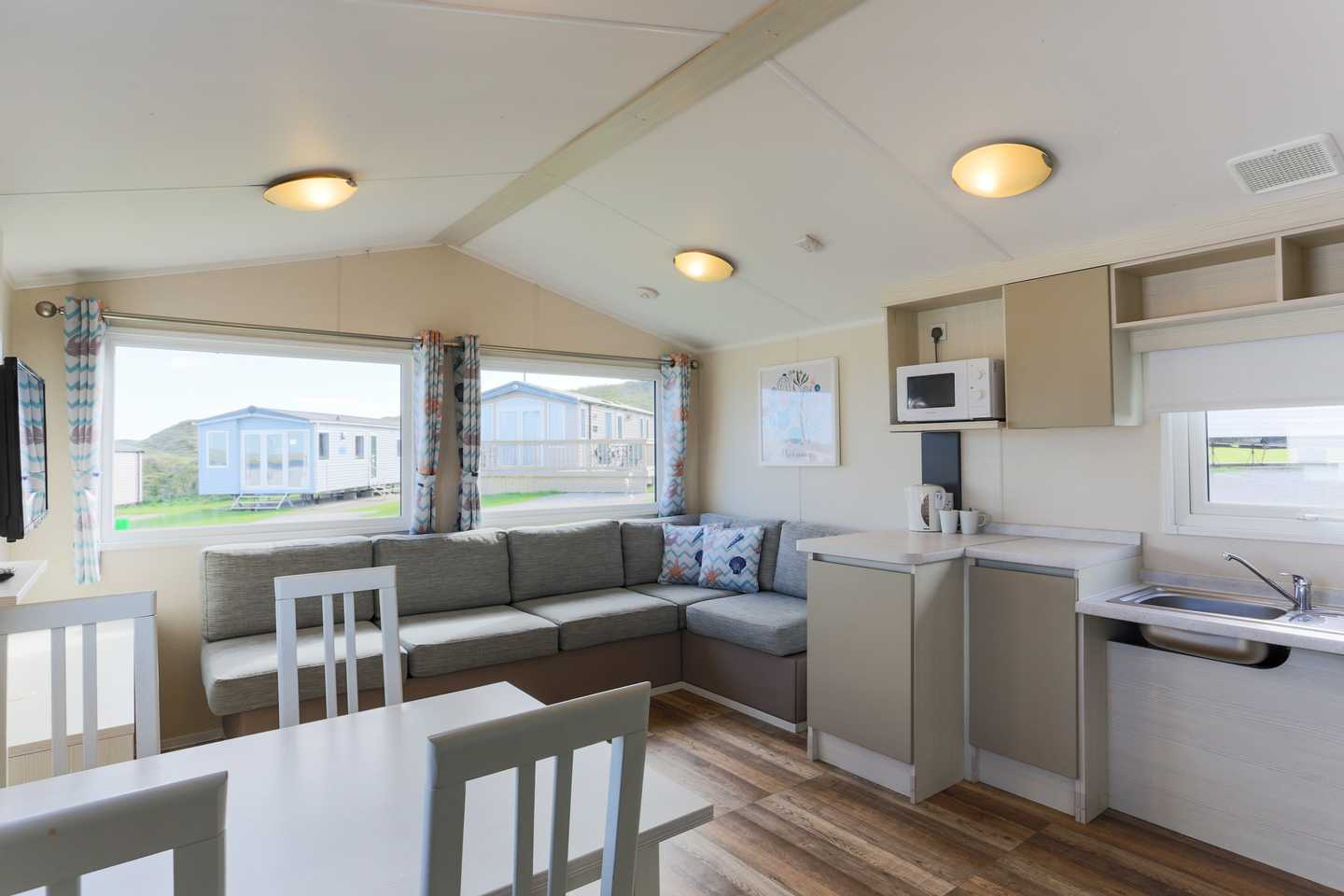 An Adapted caravan dining area with table and chairs