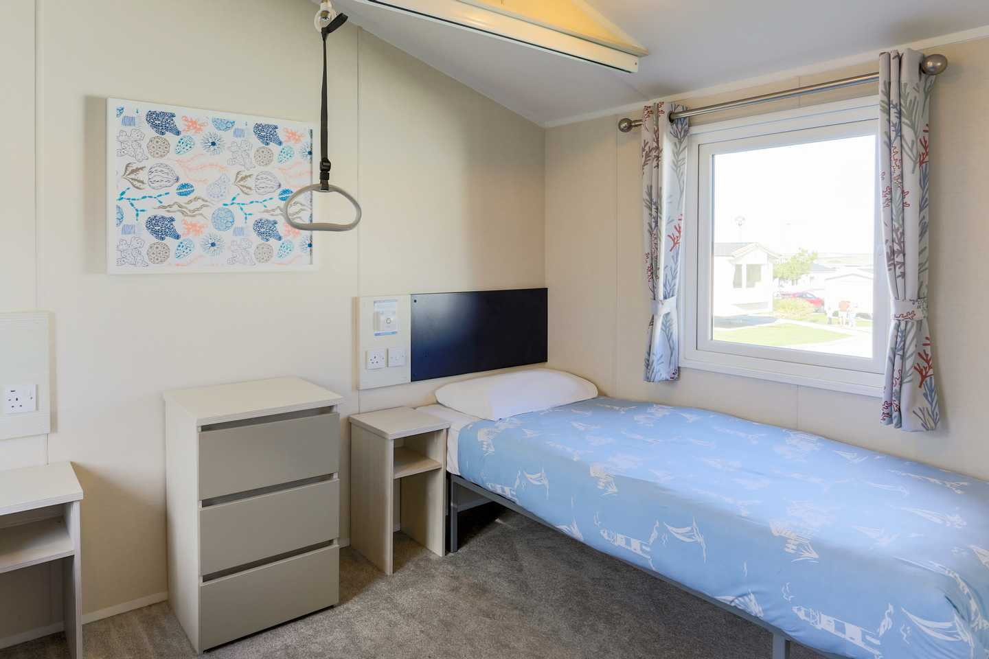 The single bed in a 2 bed Atlas Pearl adapted caravan