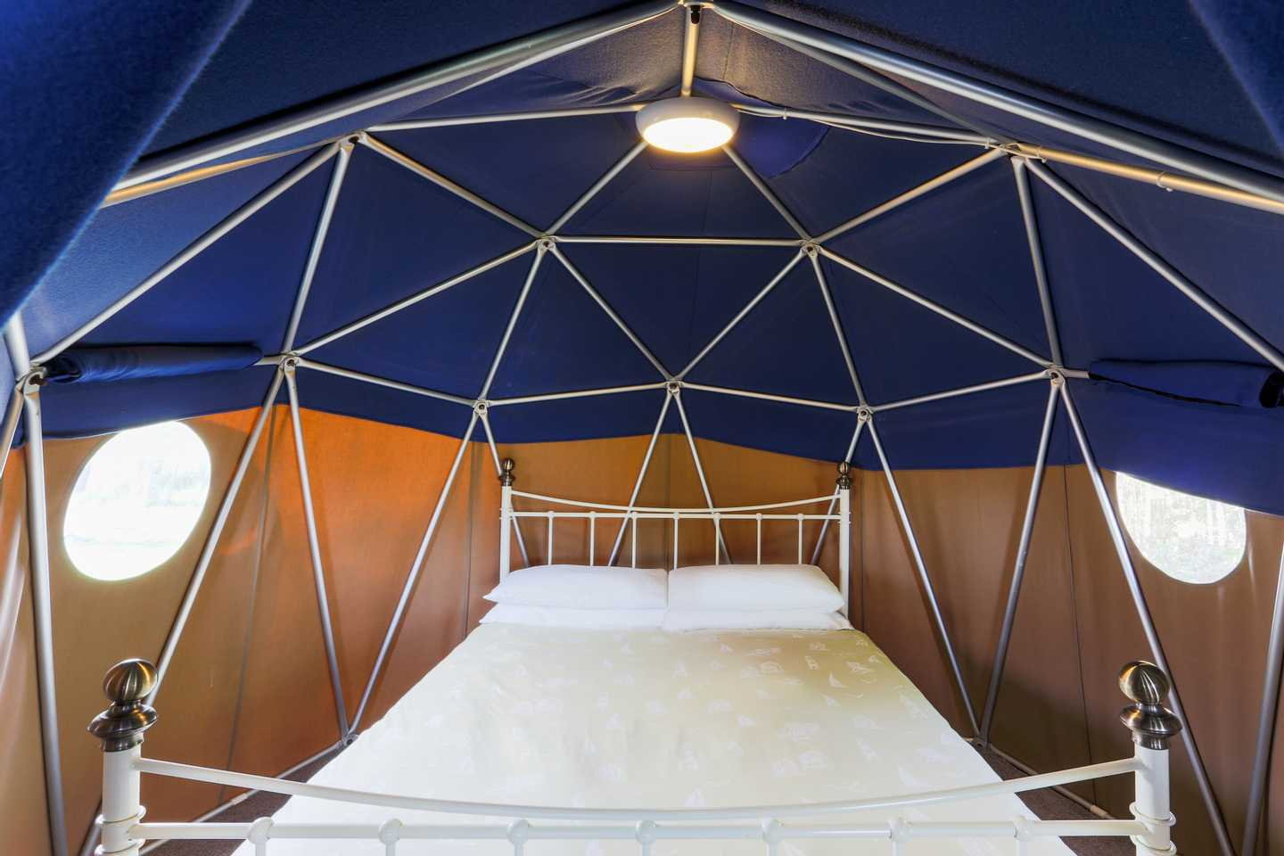 Master bedroom with double bed in a Geo Dome