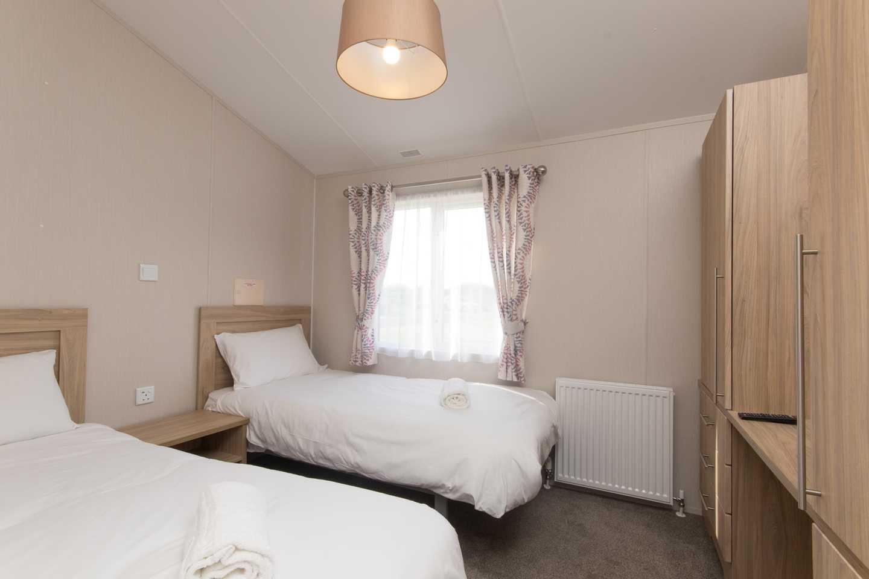 Twin bedroom in a Luxury Lodge