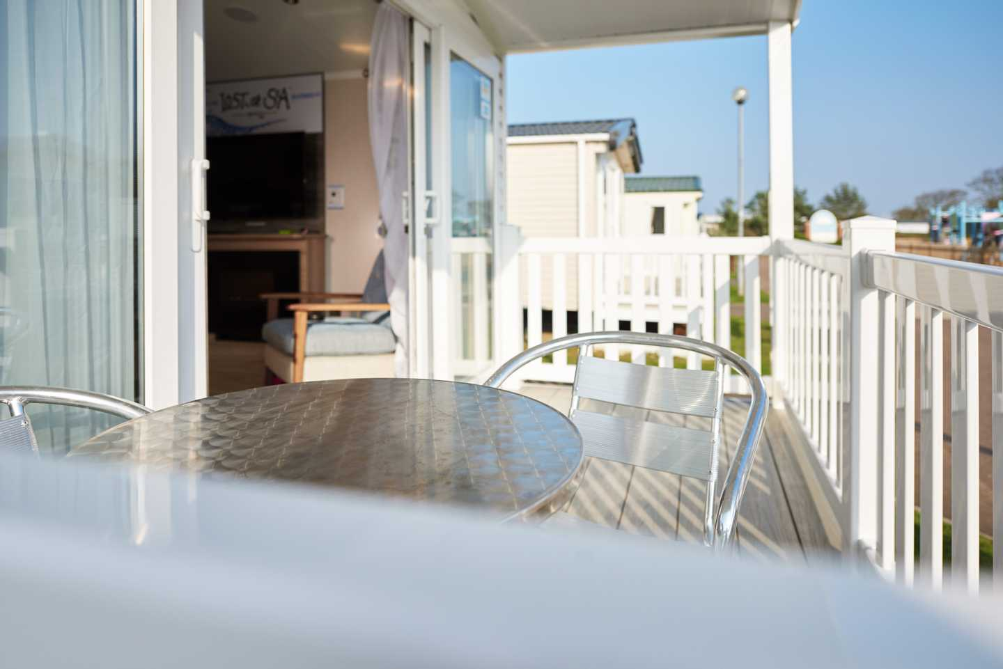 Decking area with a table and chairs