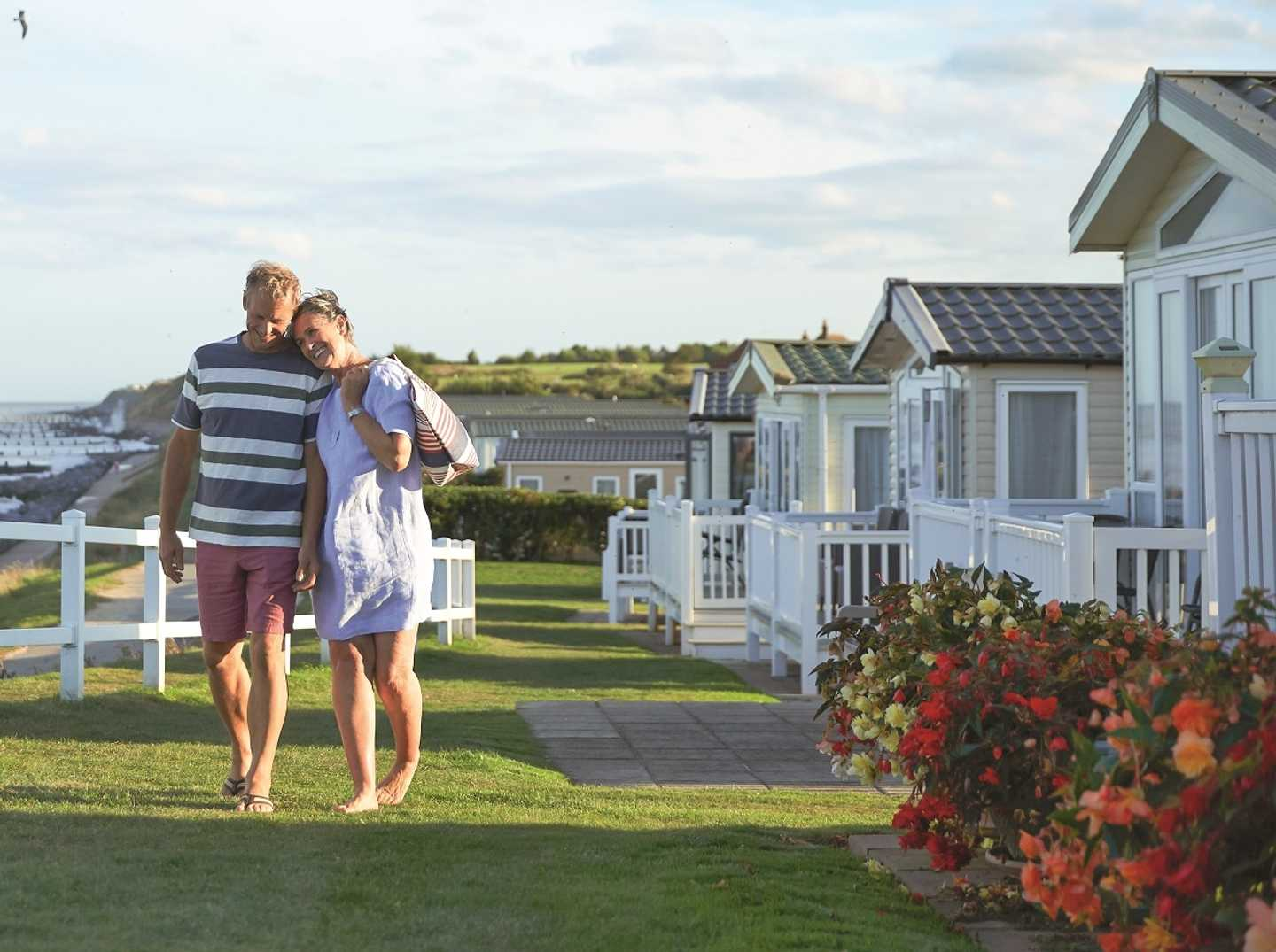 A couple strolling to Hopton's beach