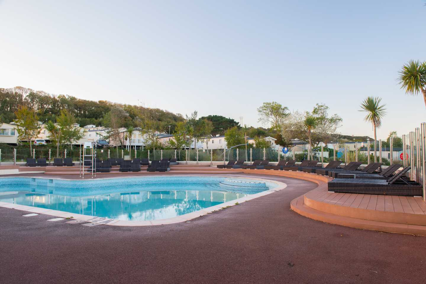 Outdoor pool with seating area at Littlesea