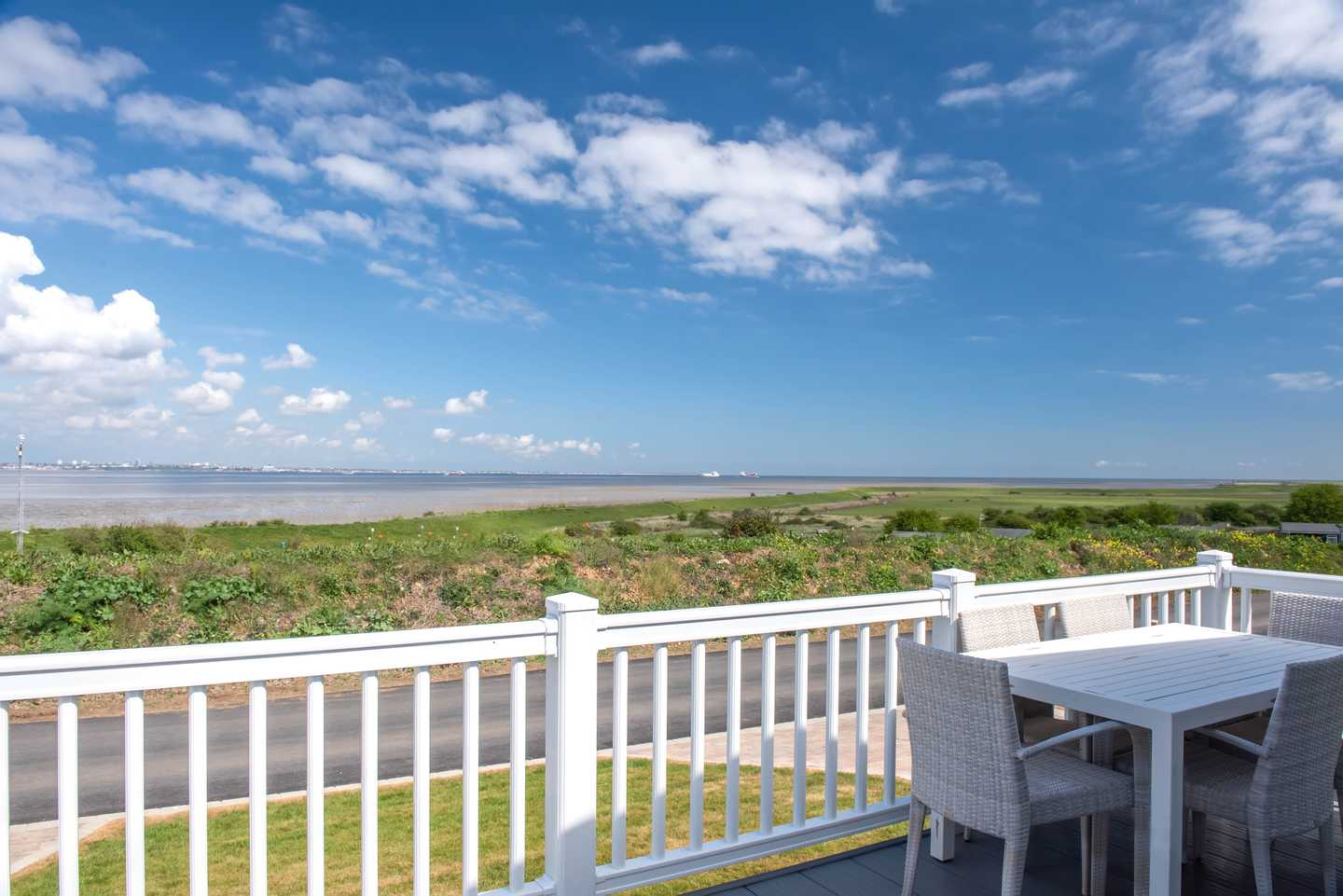 View of decking and seafront from a Platinum with decking at Lakeview