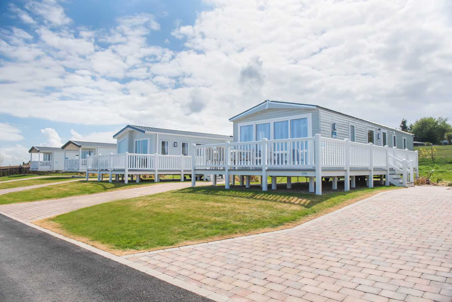 View of several New Platinum with decking at Lakeview caravans