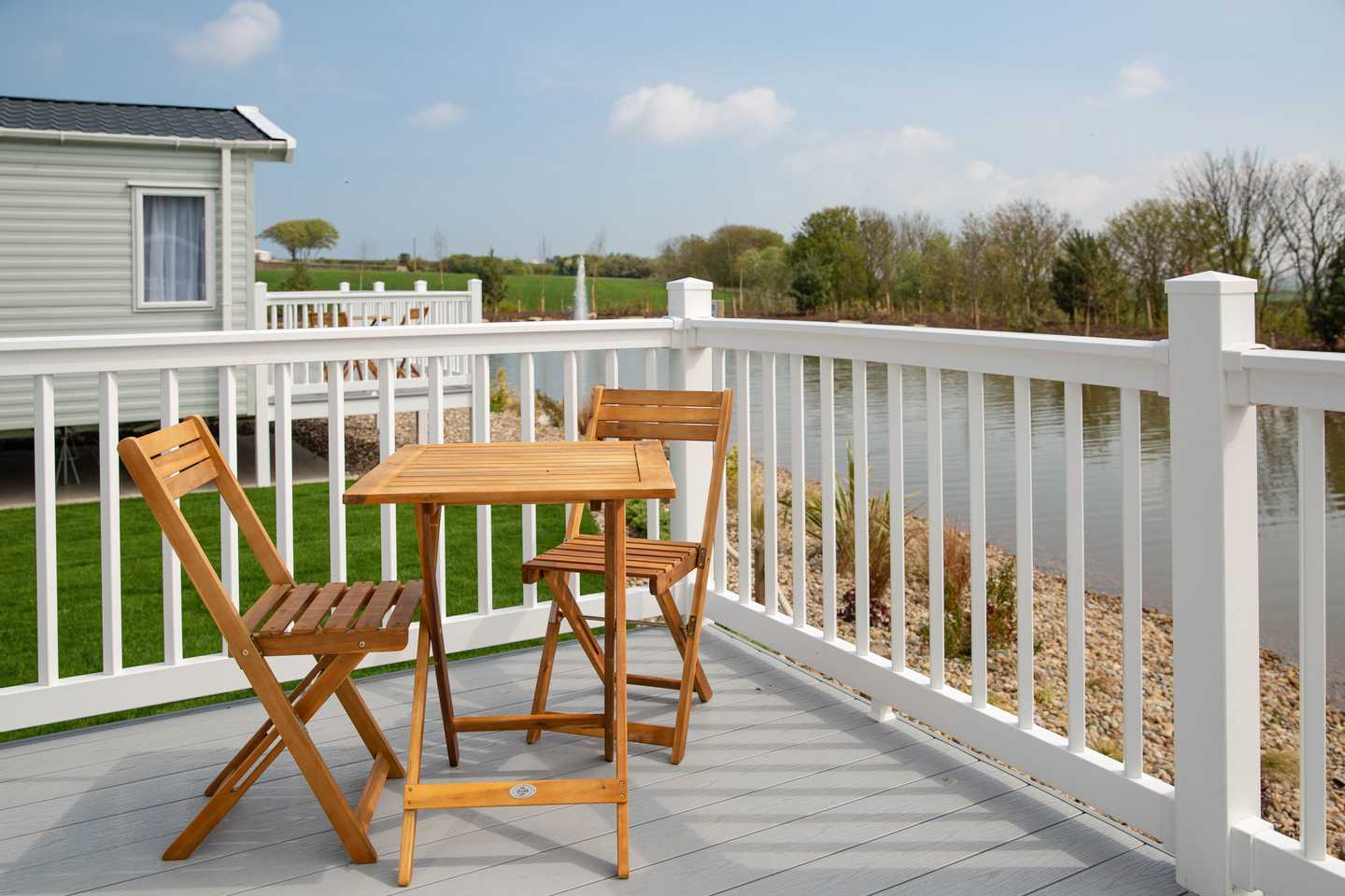 A stunning deck with table and chairs