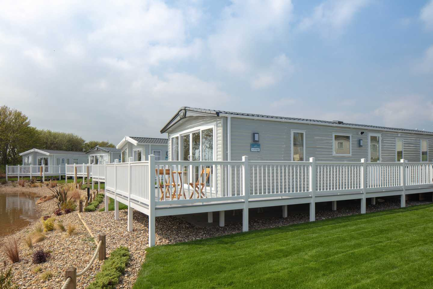View of several New Platinum with decking caravans at Wold Vale