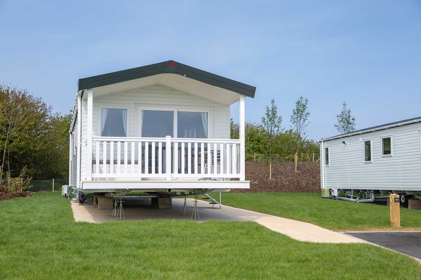 View of the front of a Prestige with decking caravan