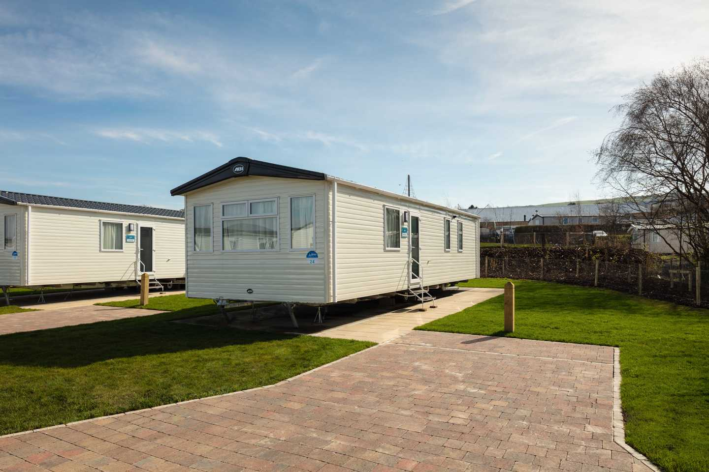 New Prestige caravan with parking space beside