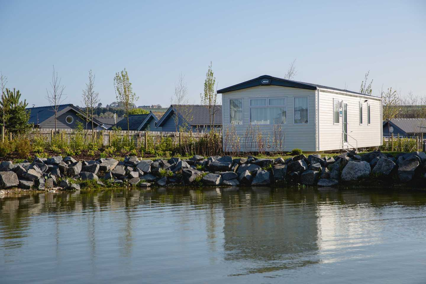 View of the exterior of a New Prestige at Seabirds on the lake
