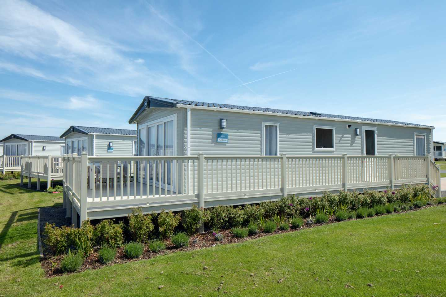 Exterior view of a Lakeside Platinum with decking at Mucklethwaite