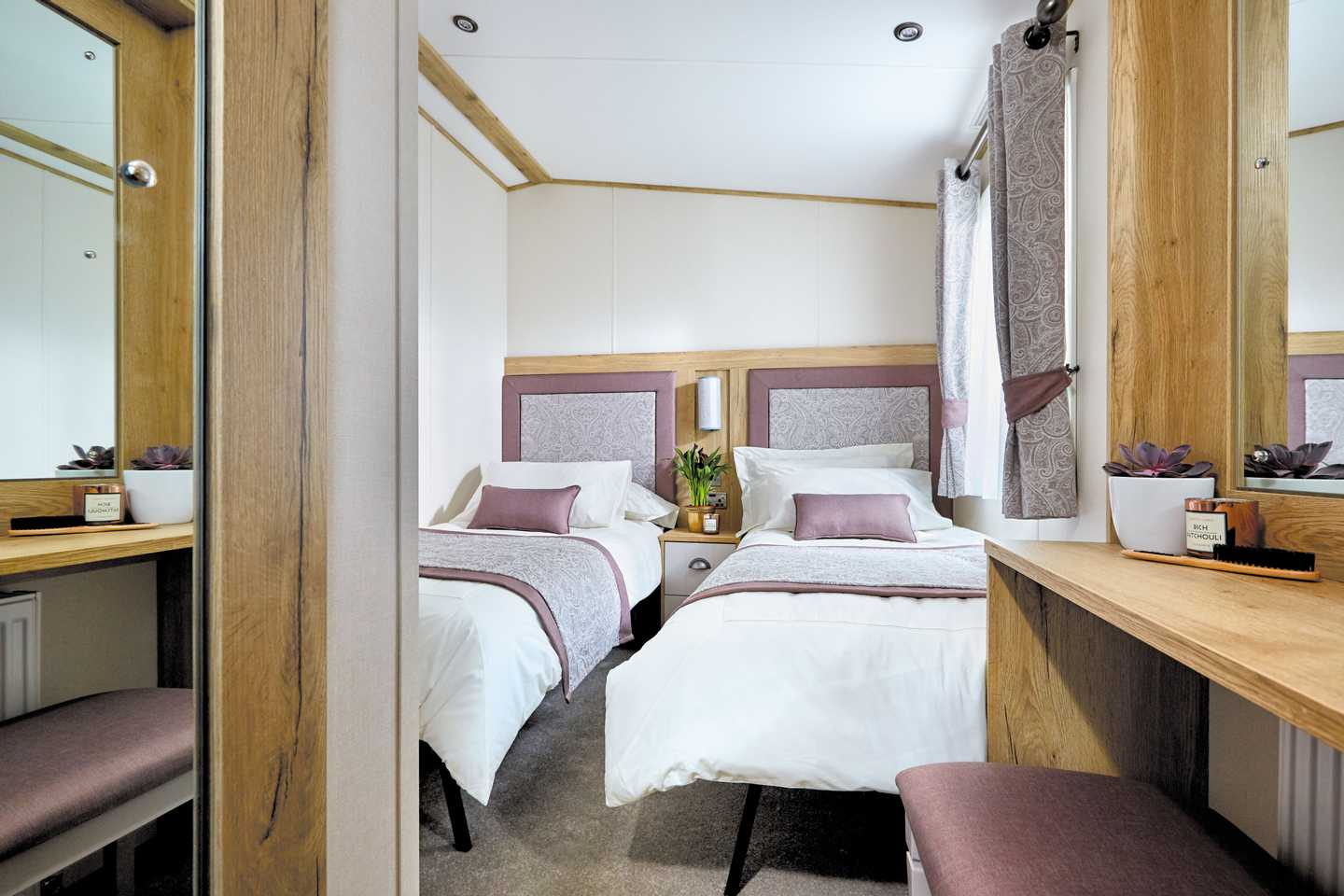 An example of the twin bedroom in a Platinum with decking caravan