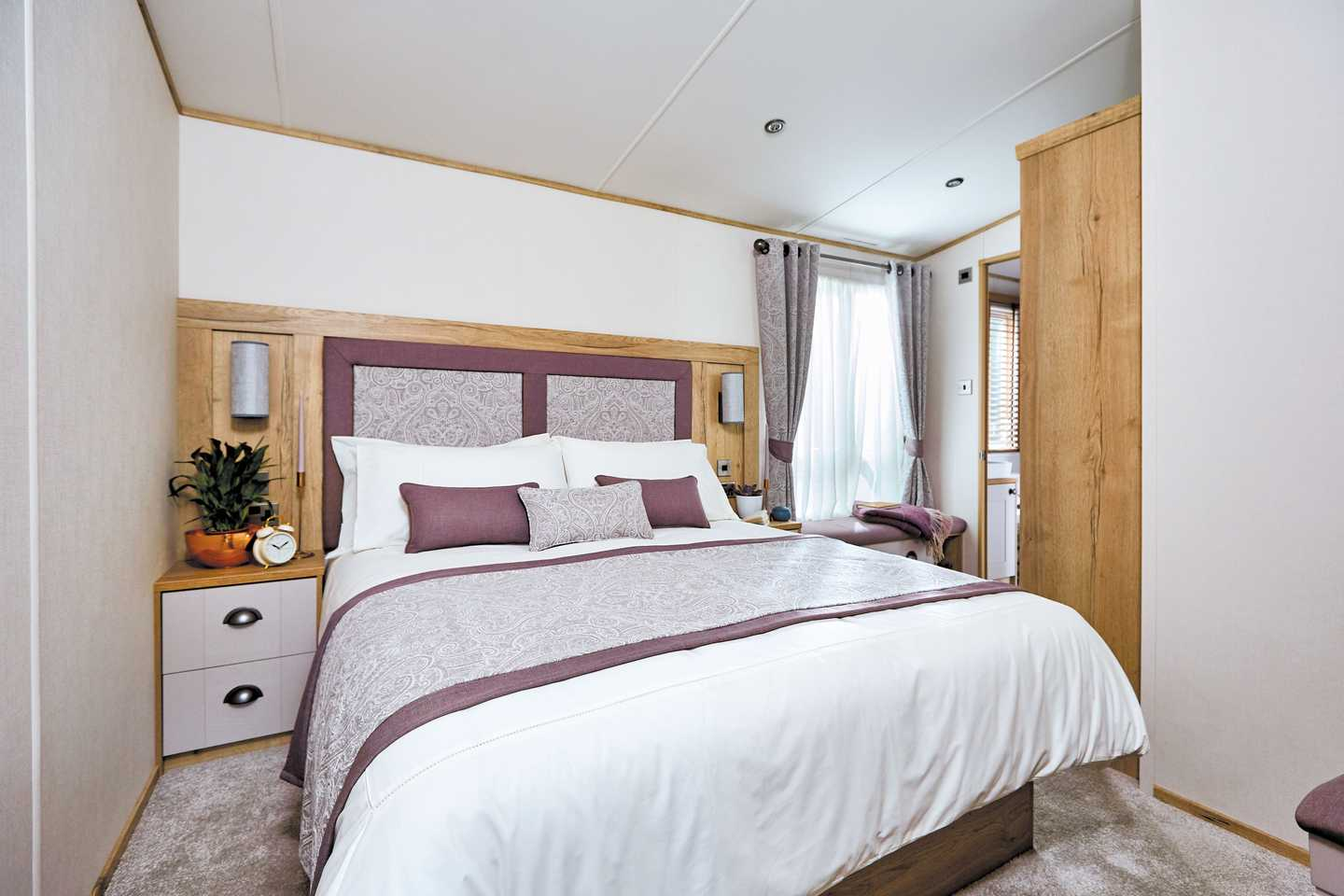 An example of the master bedroom in a Platinum with decking caravan