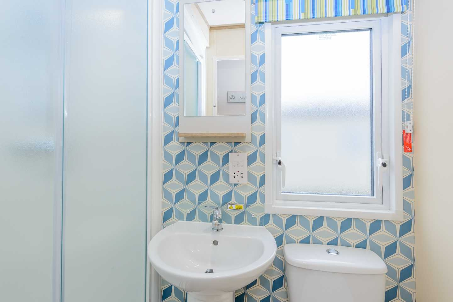 An example of the bathroom in a Deluxe caravan