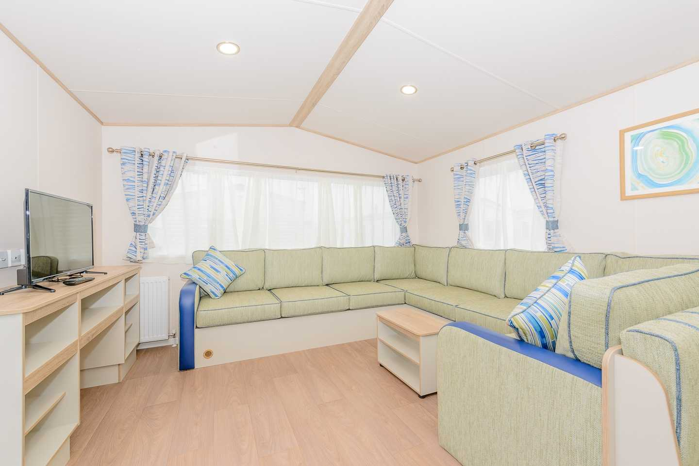An example of the lounge in a Deluxe caravan